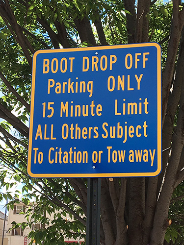 Photo of the boot dropoff parking area sign