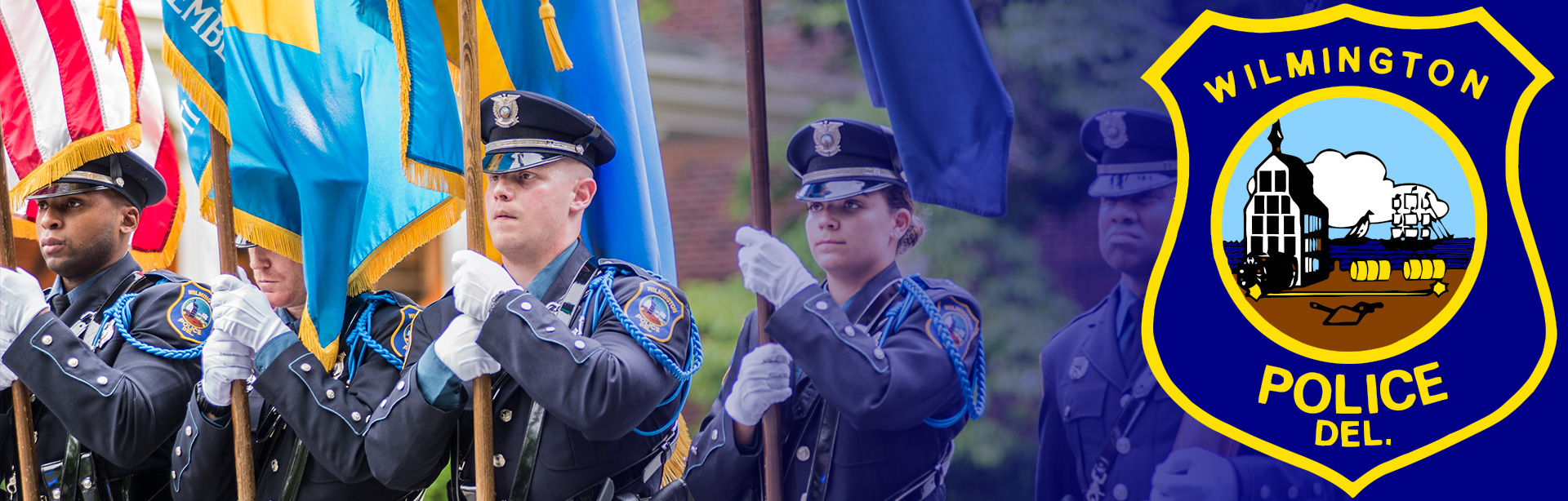 Photo of the color guard in procession during the Wilmington Police Academy ceremony.